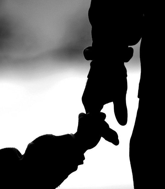 father and child hand